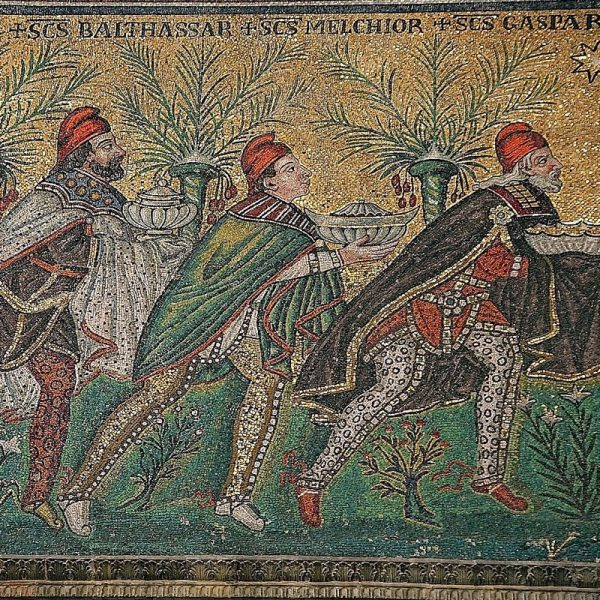 The Three Magi, Byzantine mosaic c. 565, Basilica of Sant'Apollinare Nuovo, Ravenna, Italy (restored during the 18th century). As here Byzantine art usually depicts the Magi in Persian clothing which includes breeches, capes and Phrygian caps.