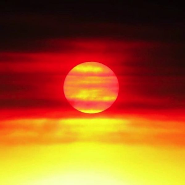 This spectacular photo was snapped at a bushfire sunset in Mandurah. Photo by Steven Powell The symbolic meaning of the flag colours (as stated by Harold Thomas) is: Black – represents the Aboriginal people of Australia. Yellow circle – represents the Sun, the giver of life and protector. Red – represents the red earth, the red ochre used in ceremonies and Aboriginal people's spiritual relation to the land.