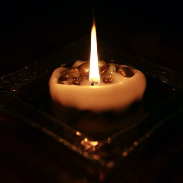 Our medium and large candle flame lingers amongst the pebbles or many hours toward the end of the candles life.