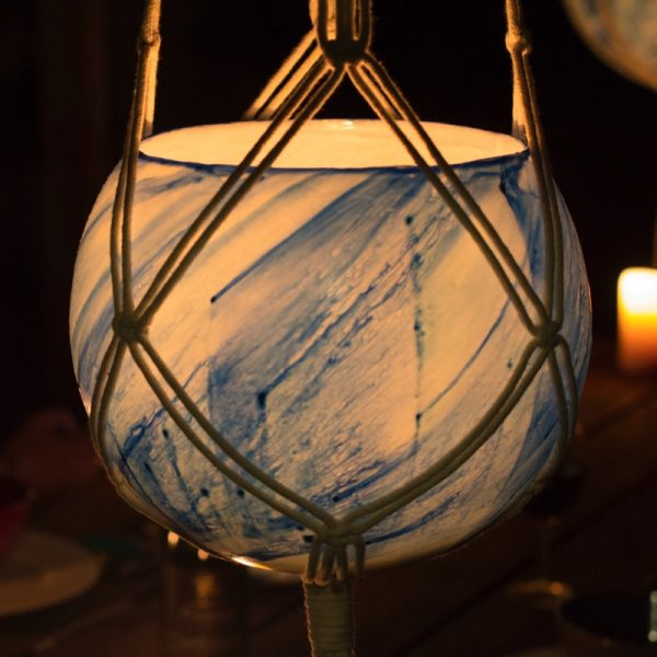 Macrame hangers are available to suit large and small lanterns. Photo by Integrity Candles.