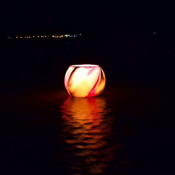 Lanterns floating in water allow you to create a unique function decoration. Photo by Frank Gumley
