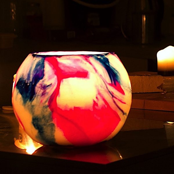 Pink and blue swirl organically. Photo by Integrity Candles.