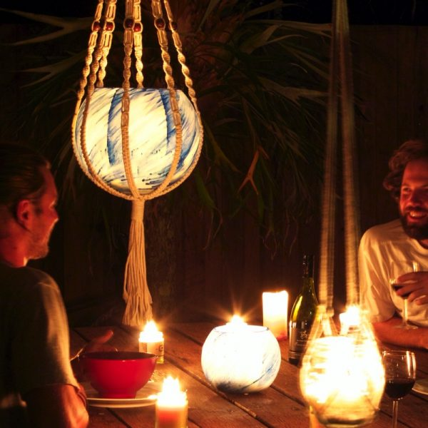 Large Blue Planet lantern in Macrame Hanger, with a small Blue Planet lantern on the table. Photo by Frank Gumley.
