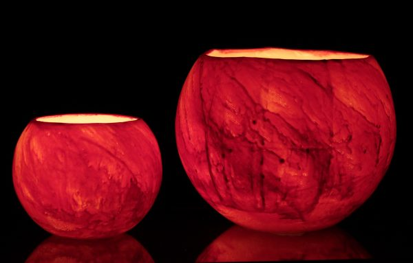 Majestic Mars Planet lantern, when lit with a Pure Soy Votive, radiates with fiery reds, highlighted with raven black. Photo By Frank Gumley
