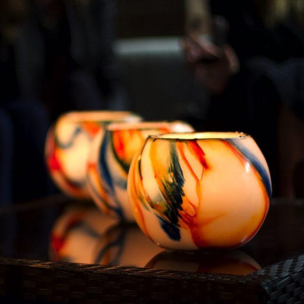 Three Blue on Orange Flare lanterns make a bold statement. Photo by Frank Gumley.