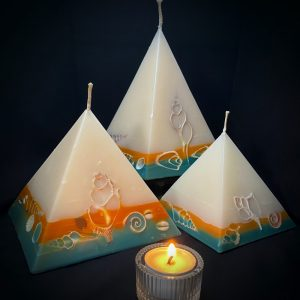 Our Lime and Coconut nest of pyramids combined burn time is over 440 hours. This tropically scented candle range is infused with essential oils of lime and coconut. White in colour, these candles feature an orange and blue banded base embedded with sea shells. As you near the end of your candle's burning, the trove of exotic shells is revealed - your lasting keepsake.
