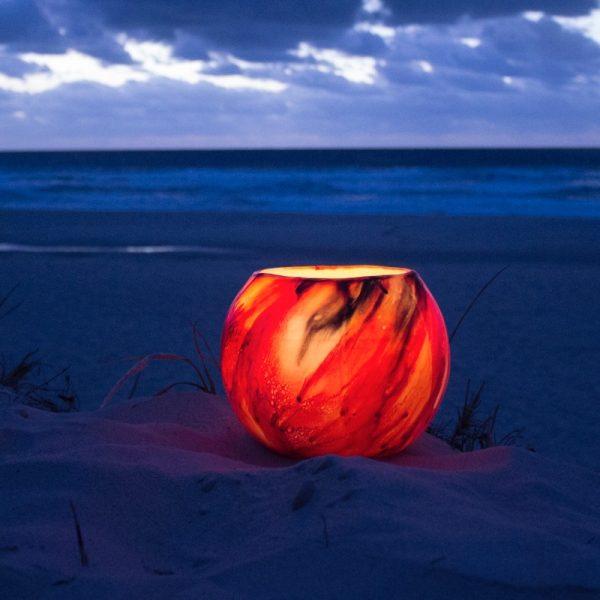 A dramatic Mars Grande lantern lights up the beach at twilight. Photo by Frank Gumley