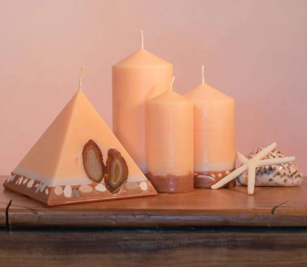 Pillar Candles and Pyramid Candles are colour-coded and scent-matched throughout the range.