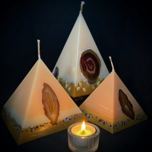 Our Vanilla nest of pyramids combined burn time is over 440 hours. As your pyramid candle burns, the flame illuminates the Agate, revealing the stone's unique variegated patterns, and leaves you with a gorgeous keepsake. Coloured in hues of cream and dusky brown and infused with Vanilla oil, this candle further features a variegated coloured base embedded with Agate Crystal slices and river pebbles.