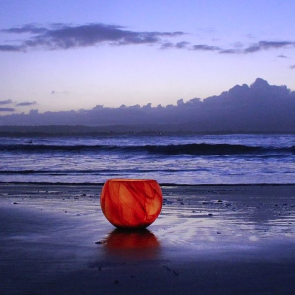 Simply beautiful, the Helios Lantern makes a striking contrast to twilight at the beach. Photo By Frank Gumley